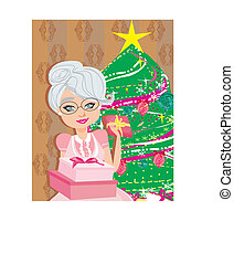 An elderly woman on the background of a Christmas tree