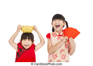 happy little girl showing red envelope and gold for chinese...