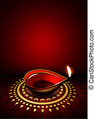 oil lamp with place for diwali greetings over dark...