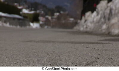 Cyclist pedaling fast - Cyclist going fast on a snowy road