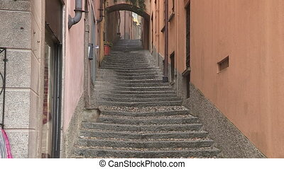 Cyclist going down a stairway in small town