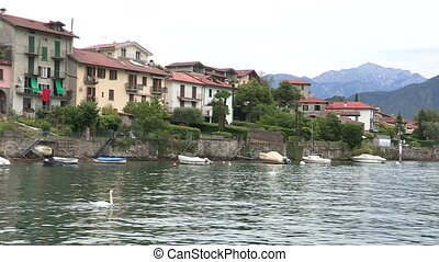 Small town on Como lake, in Italy, seen from a boat