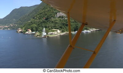 Floatplane flying on Como lake
