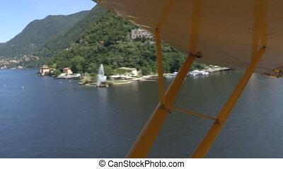 Floatplane flying on Como lake