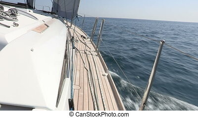 Right side of sailing boat navigating with open sails in the...