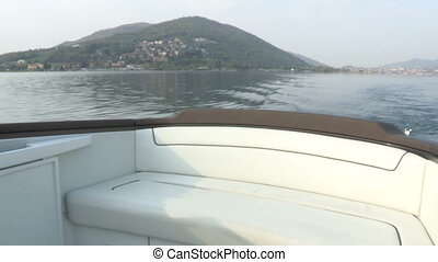 White sofa on fancy boat navigating on the lake