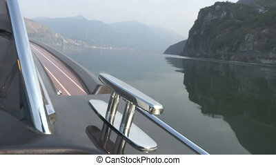 Chrome bitt on luxury boat, navigating on the lake Iseo,...
