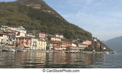 Small town on Iseo lake, seen from a boat