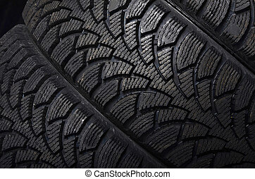 The automobile tire on black background - The automobile...
