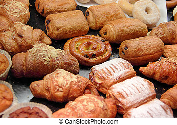 Pastry - Various tasty pastry lying on a shop counter in...