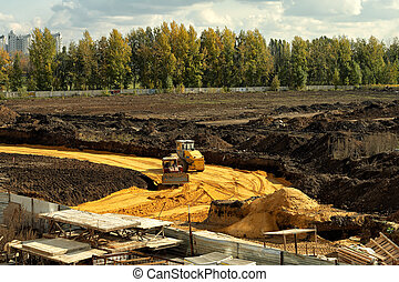 Laying the road. - Laying of a new road on the outskirts of...