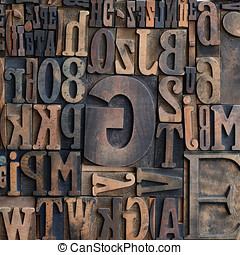 Wooden printers typeface letters - Jumbled arrangement of...