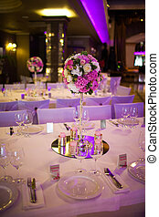 Celebratory tables in the banquet hall decorated