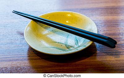 Ceramic bowl and chopsticks