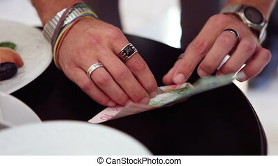 Magic tricks with money - Magician shows tricks with two...