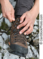 Tying the hiking boots