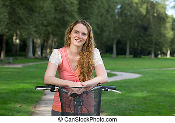 Woman on a bike in a park