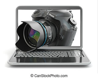 Digital photo camera and laptop Journalist or traveler...