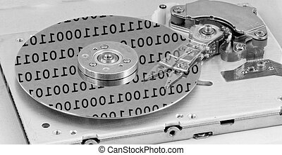 Internals of a computer harddrive with binary number...
