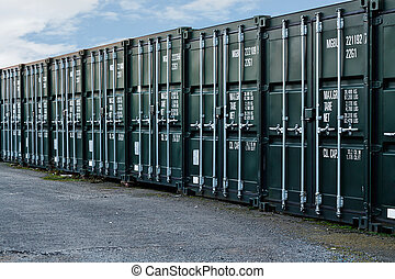 Shipping containers - line of new freight containers being...
