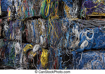 Recycling colorful cables - Bales of communication cables....