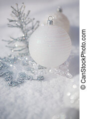 Silver Christmas tree decorations on real snow outdoors...