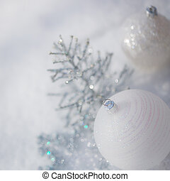 Silver Christmas tree decorations on snow - Silver Christmas...