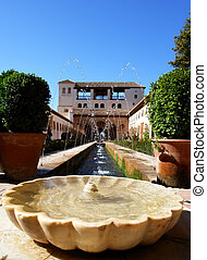 Water fountain in Alhambra ancient islamic palace...