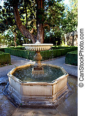 Water fountain in Alhambra ancient islamic palace (Spain)...