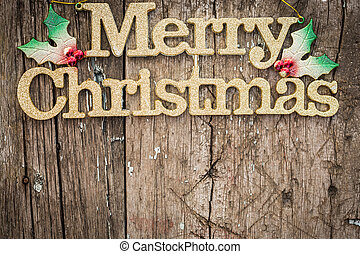Gold text quot;Merry Christmasquot; on wood - Golden text...