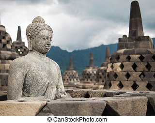 Ancient Buddha Statue at Borobudur - An ancient Buddha...