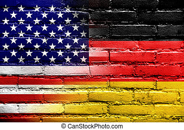 USA and Germany Flag painted on brick wall