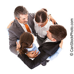 Huddle Of Businesspeople - High Angle View Of Businesspeople...