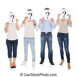 Group Of A People Holding Question Mark Sign In Front Of...