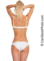 Young woman in lingerie . rear view
