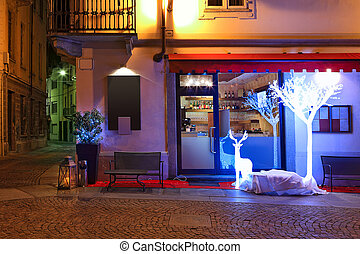 Small restaurant decorated for Christmas at evening - Small...