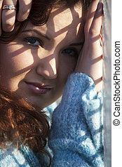 Shadowed portrait - Outdoor portrait closeup of a plus size...