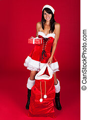Young Woman Holding Santa Bag - Young Happy Woman Looks Into...
