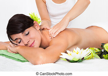 Young Woman At Spa Saloon - Woman In Spa Salon Lying On...