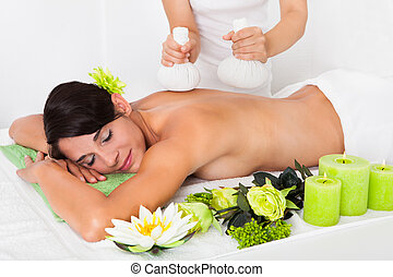 Young Woman Getting Herbal Ball Massage