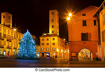 Christmas tree on city square in Alba, Italy. - Illuminated...