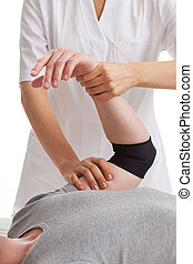 Hand physiotherapy - Woman doctor massage man's hand