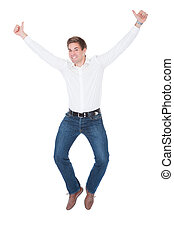 Excited Young Man - Happy Young Man Showing Thumb Up Over...