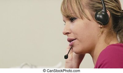 female operator in call center work - woman working as...