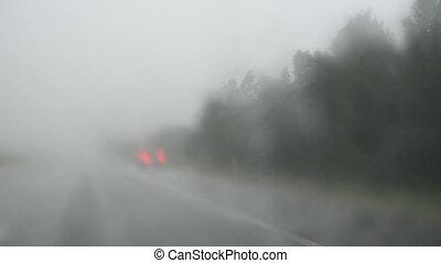 rain fall windscreen car - dense rain water fall on highway...