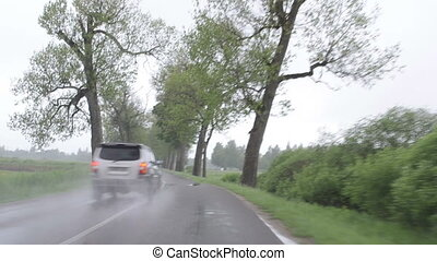 rain car windscreen - rainfall on windscreen and automobile...