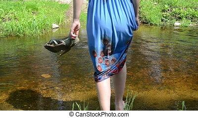 girl wade barefoot