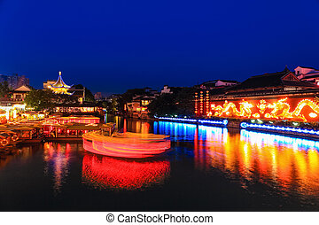 nanjing confucius temple at night,boats in the river with...