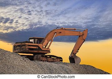 Silhouetted Digging Machine - Excavator machine on a blue...