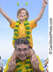 Happy brazilian father and daughter soccer fans...